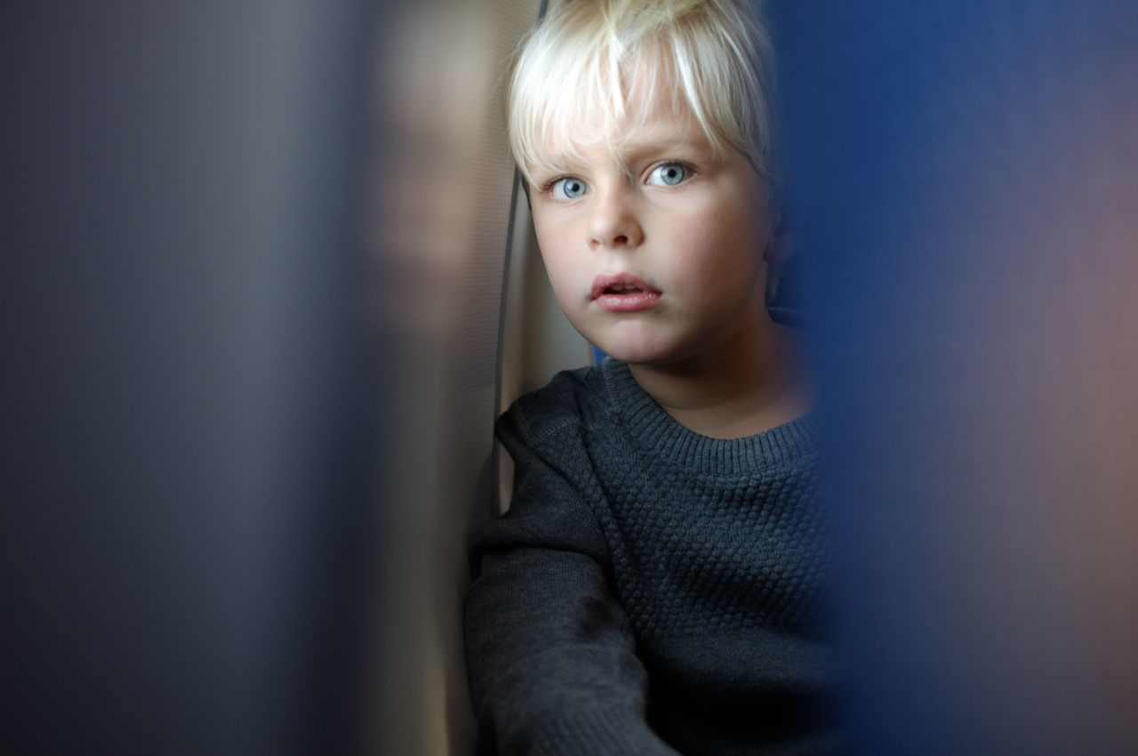 Little blue eyes of surprise // In the plane Contemplation Innocence Kid Looking At Camera Portrait Surprised