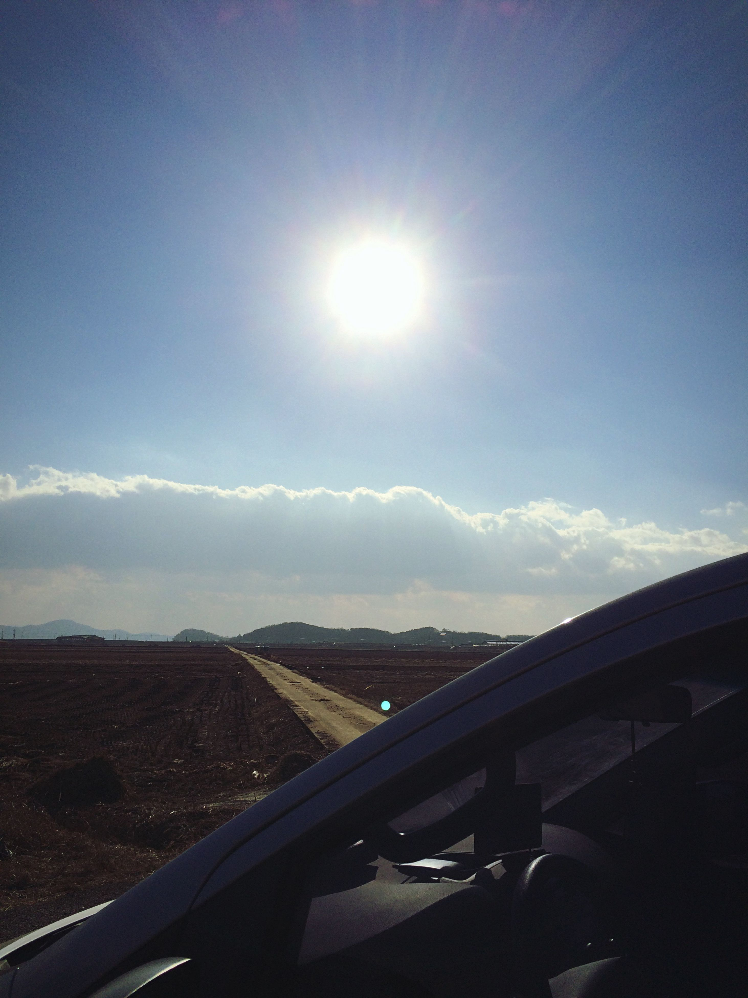 transportation, sun, sunbeam, sunlight, mode of transport, lens flare, car, sky, land vehicle, road, sunny, vehicle interior, day, travel, bright, nature, on the move, glass - material, outdoors, cloud