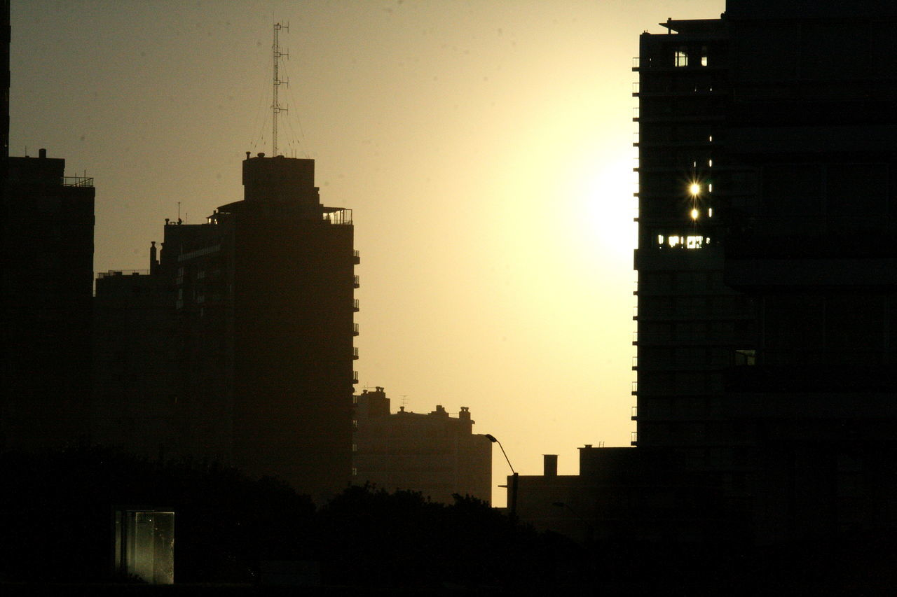 architecture, sunset, silhouette, building exterior, city, skyscraper, built structure, no people, modern, cityscape, outdoors, clear sky, sky