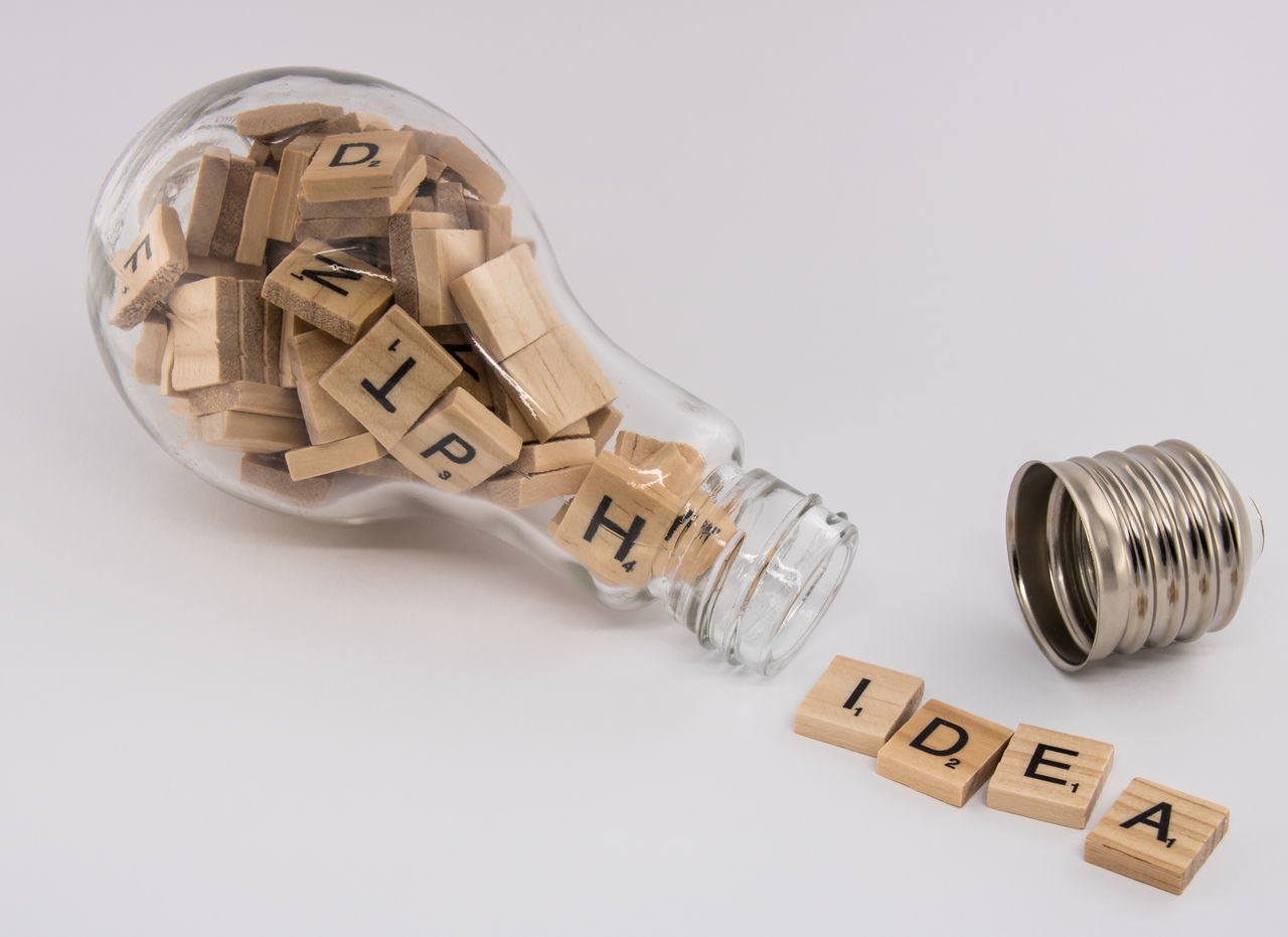 "A light bulb, with an unscrewed socket, filled with letter tiles, spitting out the word ""idea"" on a white background. This concept photograph symbolizes the process of generating an idea. A light bulb is related to the thinking concept. It is completely stuffed with letter tiles that symbolize various ideas and concepts inside of the light bulb. Like a human brain that is filled up with concepts and ideas that are not complete. When the light bulb opens up, a concept emerges. An idea is being born after a process of thinking and shuffling letters. Visualization of brainstorm. Achievement Advertising Authentic Authentic Moments Brainstorm Bulb Business Finance And Industry Concept, Glass Creativity Design Idea, Imagination Innovation Inspiration Intellectual Property Invention Original Experiences Outdoors Pattern Simplicity Solution Success Talent Theory Thought First Eyeem Photo"
