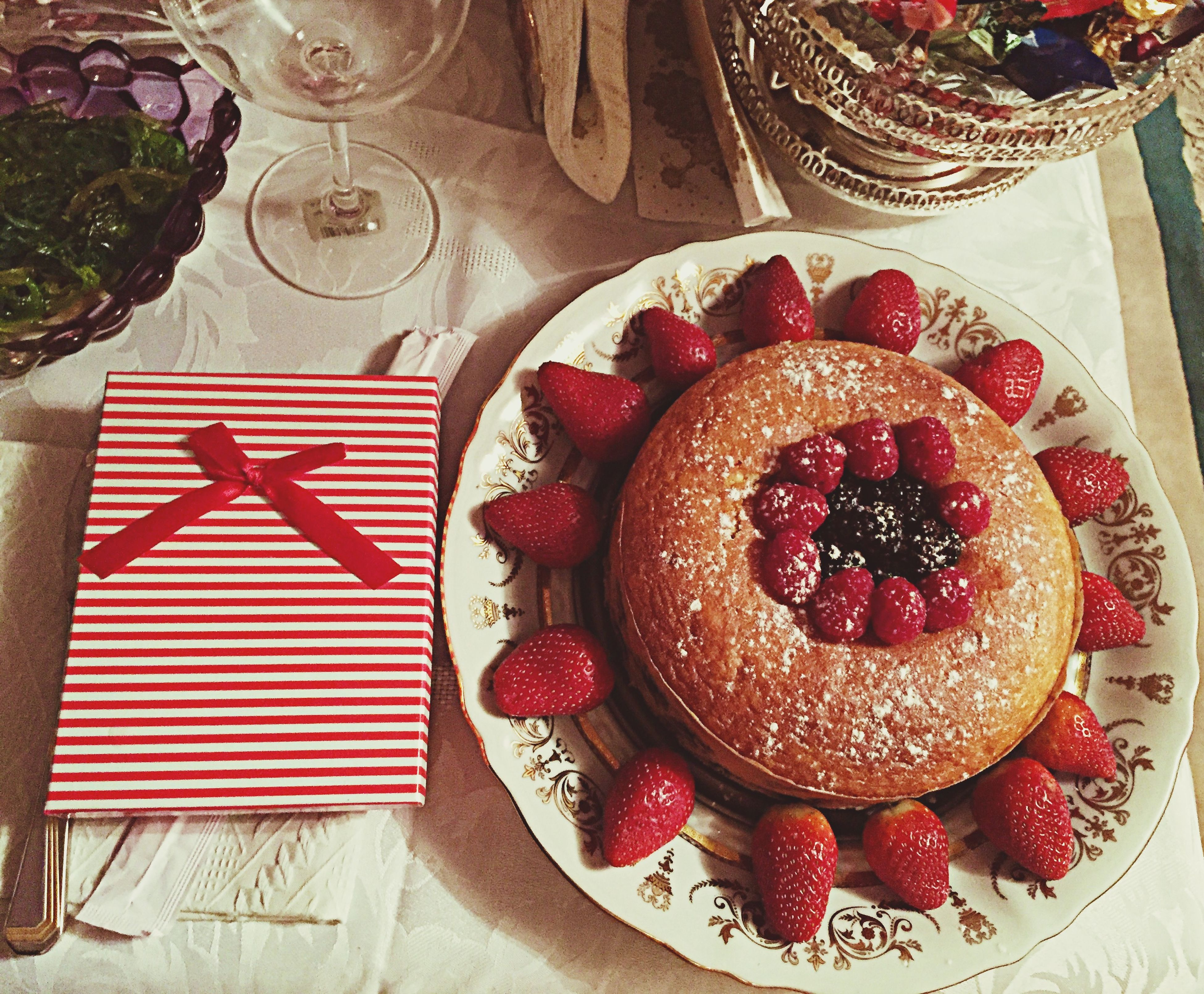 indoors, food and drink, red, food, table, sweet food, strawberry, freshness, still life, plate, dessert, ready-to-eat, indulgence, fruit, cake, unhealthy eating, high angle view, tablecloth, temptation, decoration