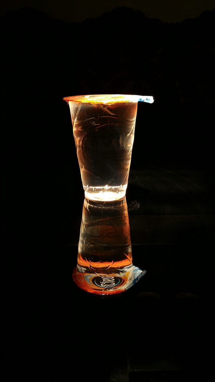 black background, drinking glass, drink, no people, refreshment, food and drink, studio shot, alcohol, close-up, illuminated, night, freshness, table, shot glass, cocktail, cold temperature, indoors