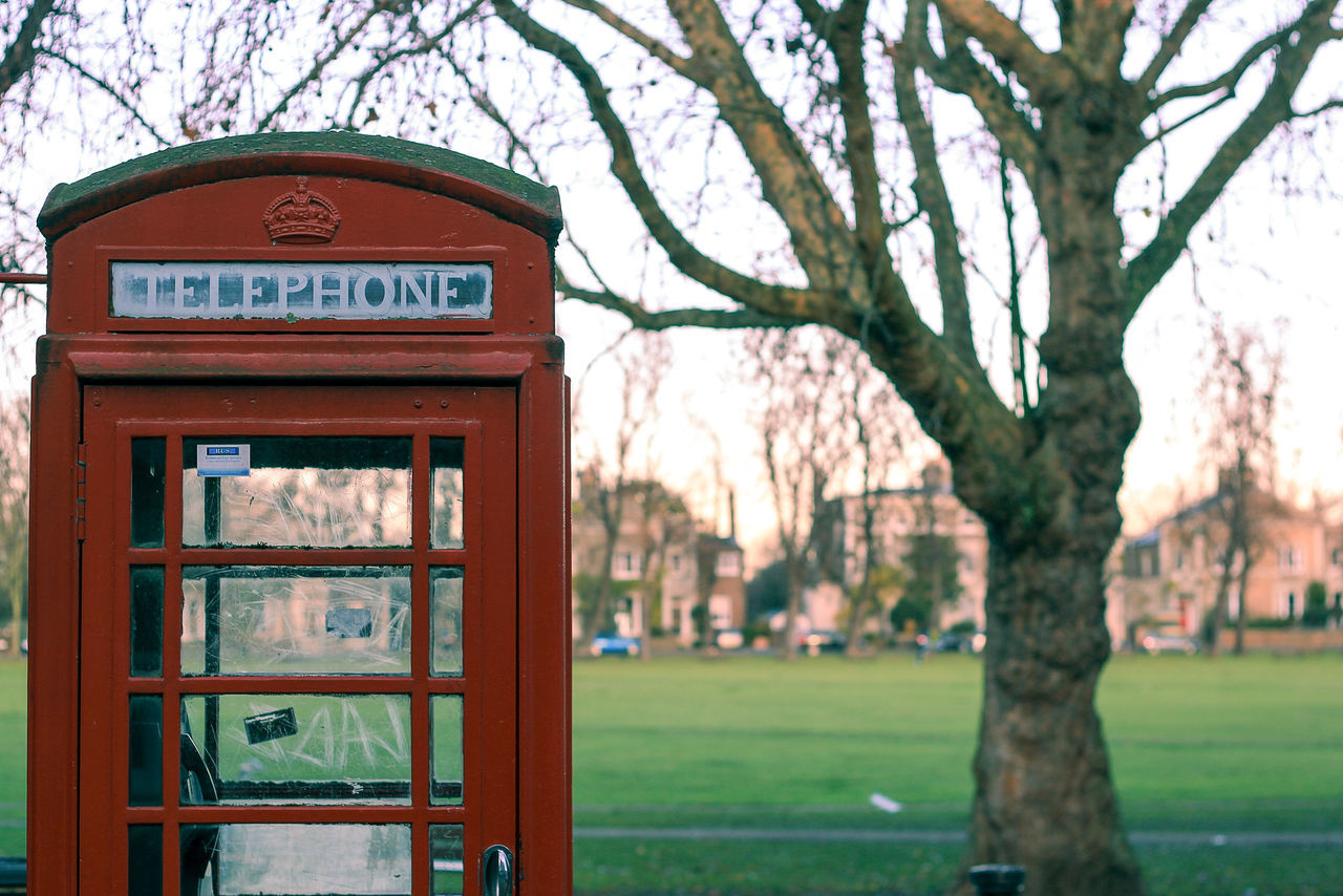 Communication Day London No People Old-fashioned Outdoors Pay Phone Red Phone Boxes Technology Telephone Telephone Booth Text Tree