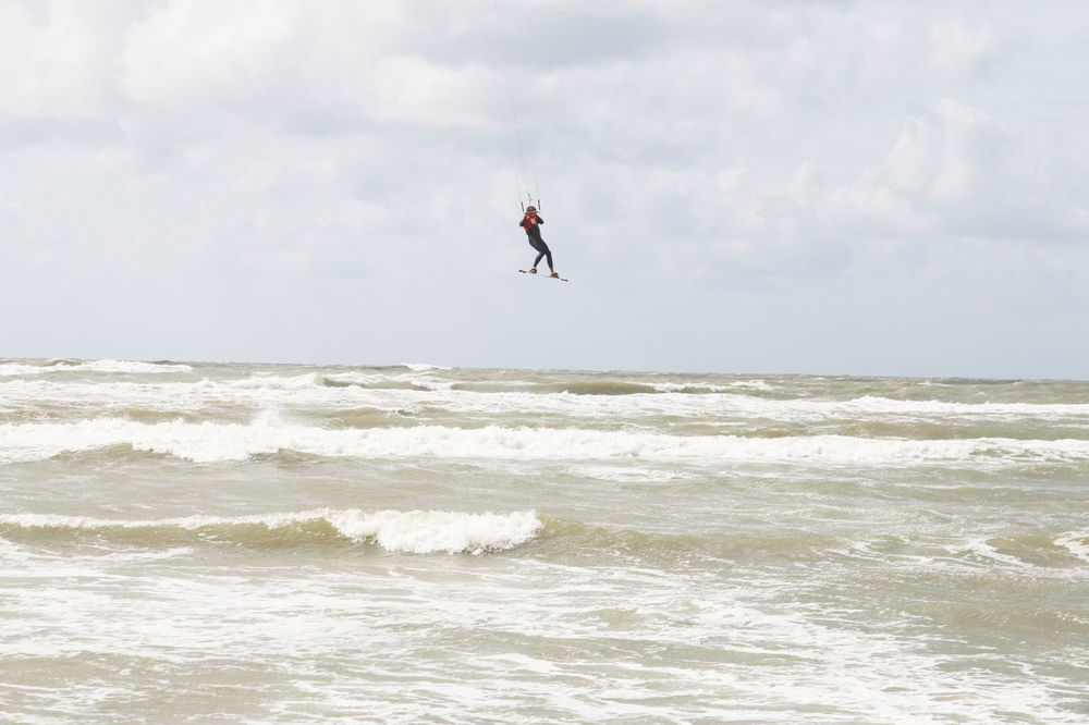 Adult Beauty In Nature Day Extreme Sports Flying Full Length Horizon Over Water Jumping Kiteboarding Leisure Activity Men Mid-air Motion Nature One Person Outdoors People Sea Skill  Sky Sport Stunt Person Surfing Water Wave