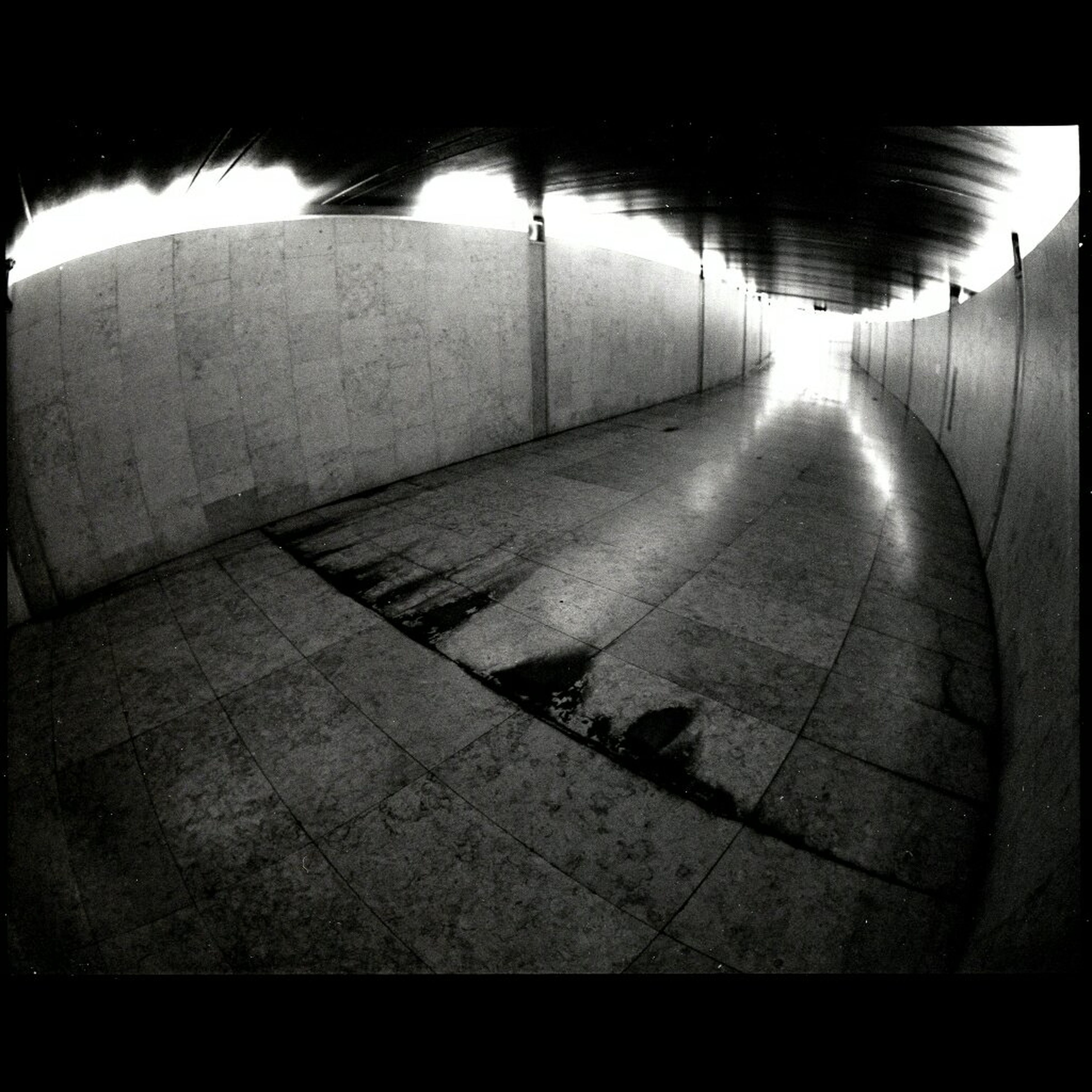 indoors, the way forward, built structure, architecture, empty, diminishing perspective, wall - building feature, absence, shadow, sunlight, auto post production filter, tunnel, cobblestone, wall, flooring, walkway, transfer print, no people, vanishing point, tiled floor