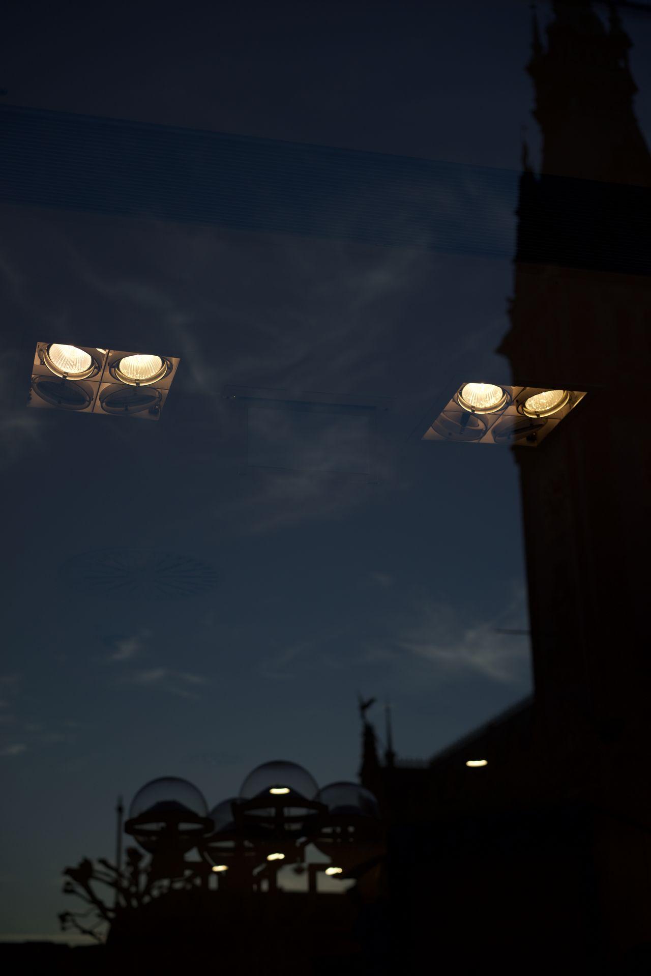 Lights mirroring in window Cloud - Sky Illuminated Lights Mirroring In Window Low Angle View No People Outdoors Reflection Sky Spotlights
