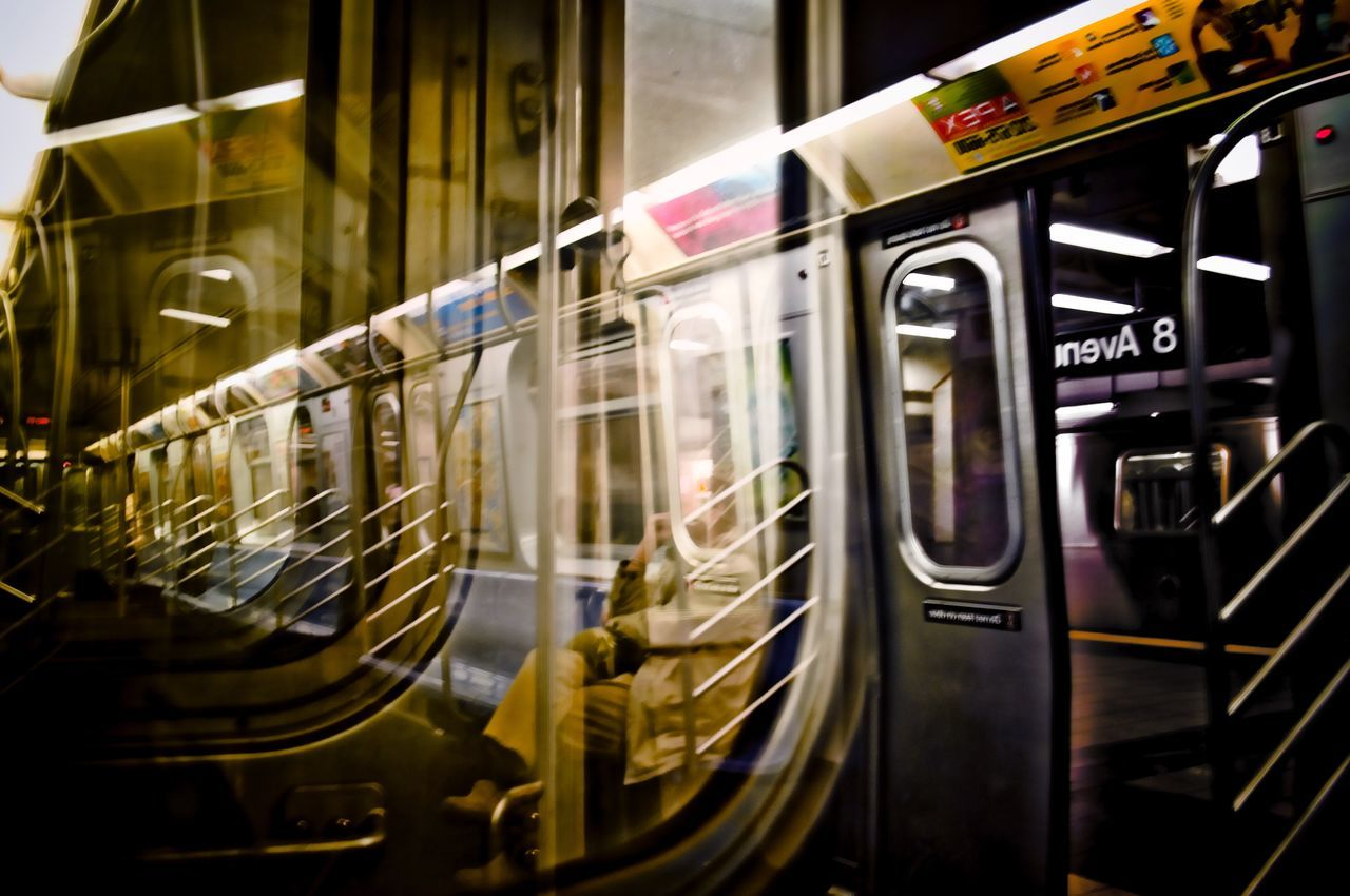 Man on the train. Subway Subway People Through The Window Subway Station L Train 8th Avenue  Subway Train People Watching Reflection Through The Looking Glass Looking To The Other Side On And On FiveSigmaPhoto City Life Backwards