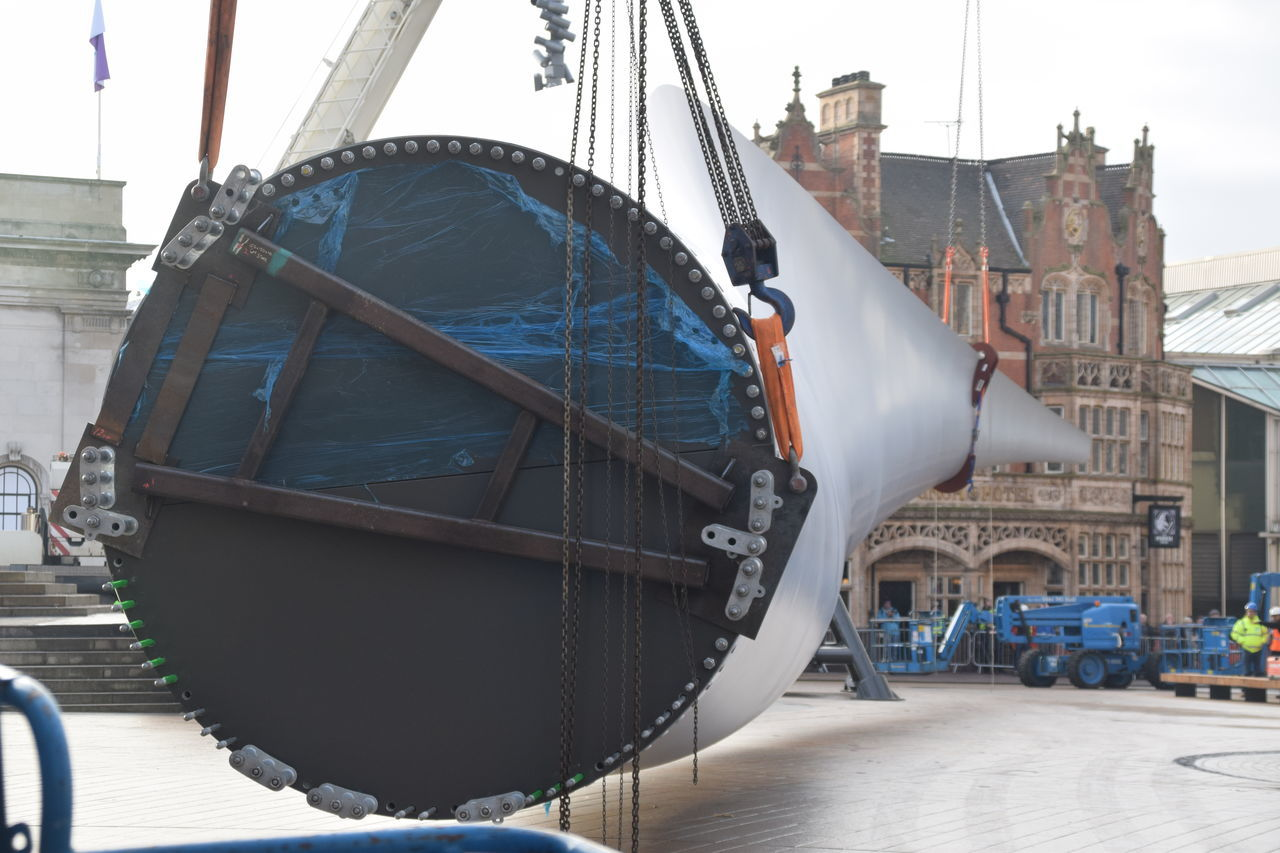 Siemens wind turbine blade is lifted into position in Hull's Queen Victoria Square (08/01/2017) during Hull 2017 City Of Culture Blade Day Hardhat  Hull Hull 2017 Hull City Of Culture 2017 Hull2017 Industry Nautical Vessel No People Outdoors Repairing Siemens  Sky Transportation Turbine Wind Turbine