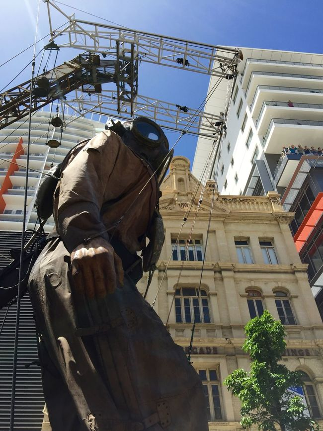 PERTH, AUSTRALIA-FEBRUARY 14, 2015: Journey of the Giants, Giant Marionette Diver view from below, public International Arts Festival Art Art Event Australia Australianshepherd Belts And Pulleys City Cityscape Crane Crowds Culture Diver Festival Giant Human International Journey Marionette People Puppeteers Walking Winchester Wooden