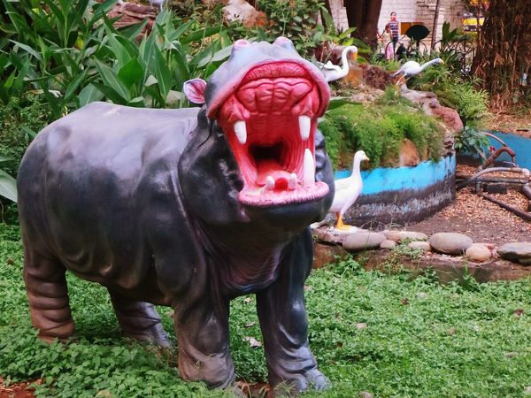 Hippo statue at CubbonPark in Bangalore. Park Birds Statue Walking Around