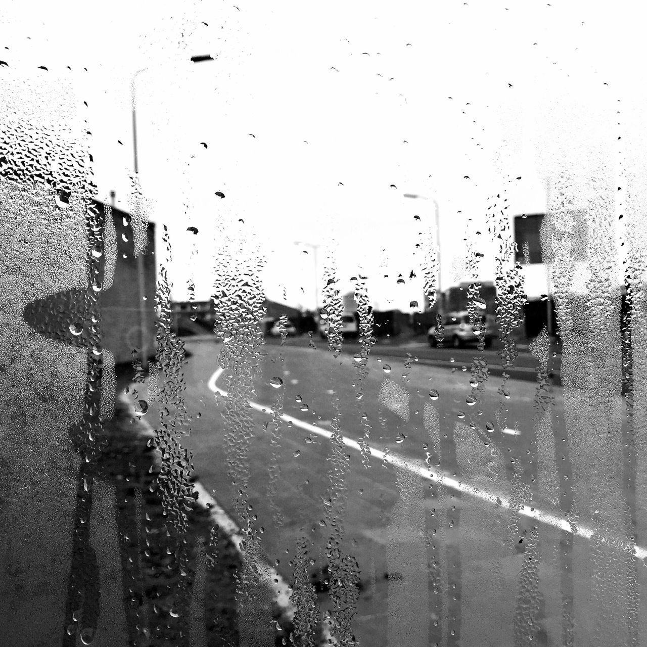 rain, transparent, wet, glass - material, window, drop, water, rainy season, transportation, land vehicle, raindrop, weather, mode of transport, car, no people, windshield, day, architecture, built structure, road, building exterior, outdoors, close-up, sky
