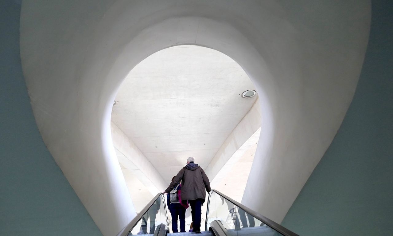 Discover  New Things  Escalator Unknown Journey Two People Real People Walking Full Length Indoors  Day One Person Men Contrast Bow
