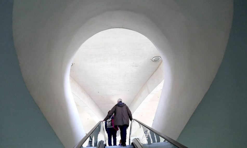 Discover  New Things  Escalator Unknown Journey Two People Real People Walking Full Length Indoors  Day One Person Men Contrast Bow The Secret Spaces