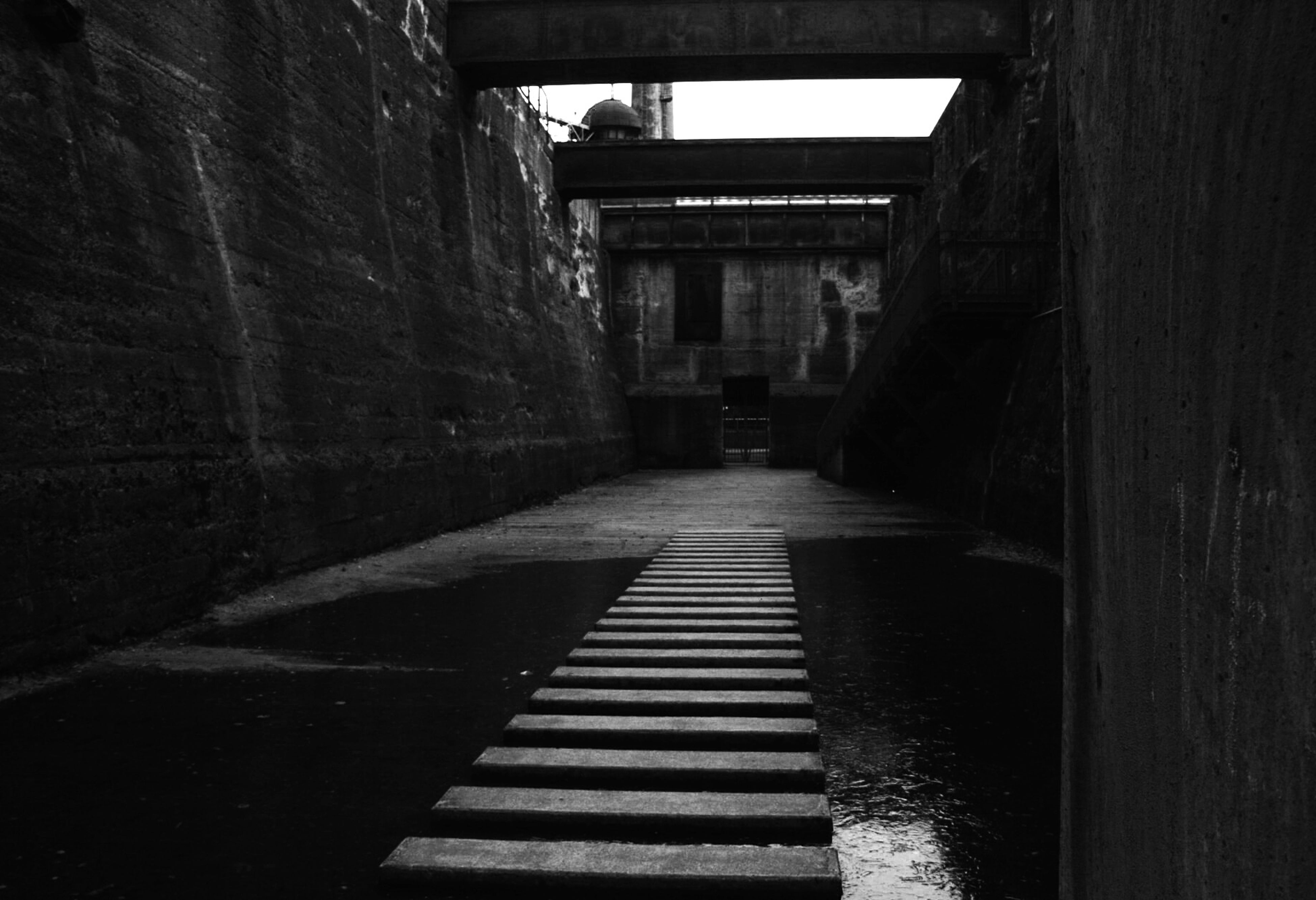 built structure, architecture, steps, water, the way forward, building exterior, staircase, steps and staircases, railing, building, diminishing perspective, narrow, day, sunlight, waterfront, reflection, no people, canal, outdoors, stairs