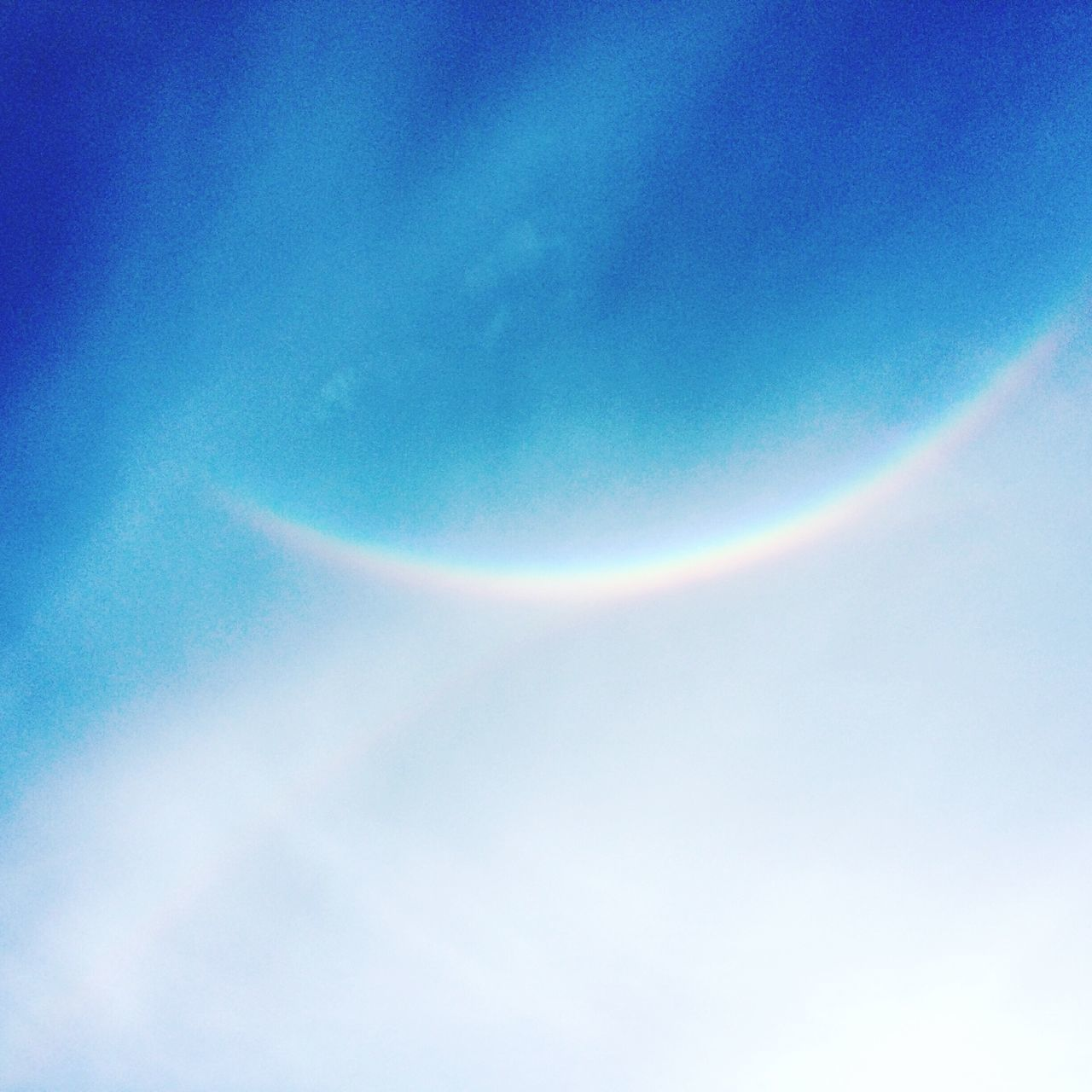 rainbow, beauty in nature, nature, scenics, sky, low angle view, halo, idyllic, no people, double rainbow, outdoors, tranquility, day, blue, natural phenomenon, sky only, spectrum, vapor trail, astronomy