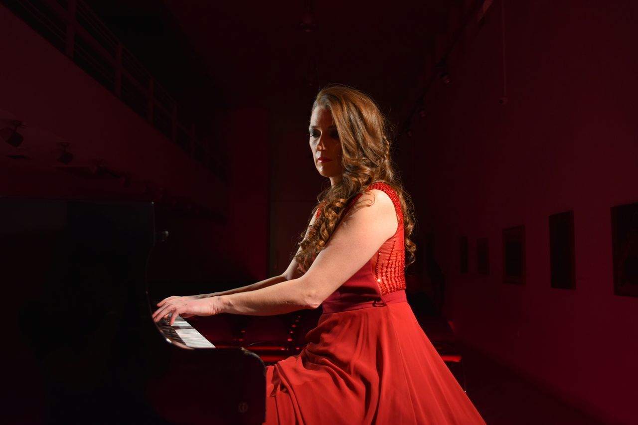 One Woman Only Arts Culture And Entertainment Glamour Red Evening Gown Piano Player Red Dress Piano Moments Concert Photography Concert Classical Concert Piano