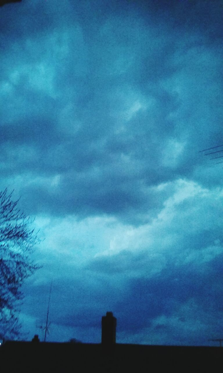 sky, cloud - sky, silhouette, low angle view, no people, nature, built structure, outdoors, architecture, beauty in nature, building exterior, day, scenics, storm cloud