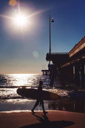 Under the sun Hanging Out Enjoying Life People Watching Venice Beach Shooting Strangers From Where I Stand Life Is A Beach On The Beach Life Is Waiting Sunshine ☀ Warm Colors Silhouette Beachphotography Surf Enjoying The Sun Pier
