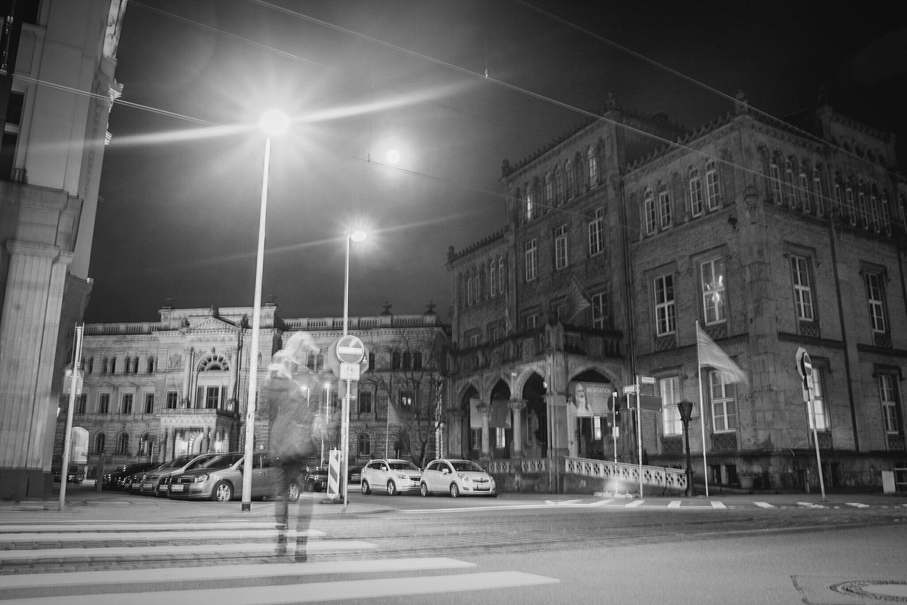 ~ 🚶🌃~ City Night Illuminated Architecture Outdoors Desaturated People Long Exposure Streetphotography Street Blackandwhite Monochrome Architecture_collection Motion Getting Inspired Light And Shadow Lines And Shapes Low Angle View Nightphotography Night Lights Moon Black & White Blackandwhite Photography Blanco Y Negro Architecture_bw