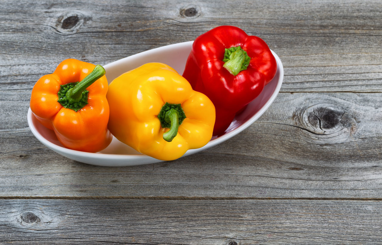 Whole Bell Peppers in bowl Bell Pepper Close-up Food Food And Drink Freshness Healthy Eating No People Raw Food Red Red Bell Pepper Vegetable Wood - Material