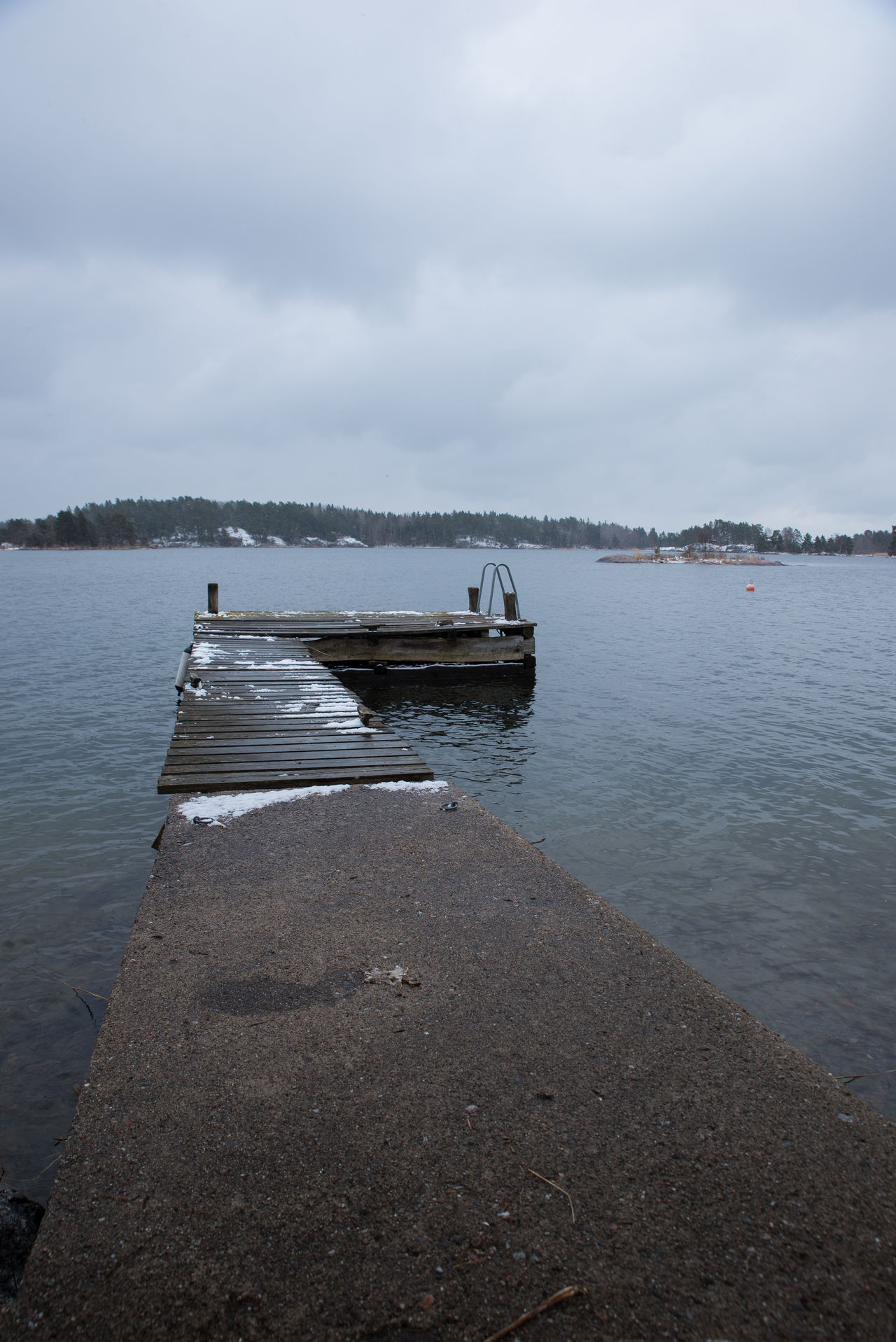 A cloudy day in the Stockholm archipelage. Snow is covering the dock but the water is open. Beauty In Nature Cloud - Sky Day Lake Mode Of Transport Nature Nautical Vessel No People Outdoors Scenics Sky Tranquil Scene Tranquility Transportation Tree Water