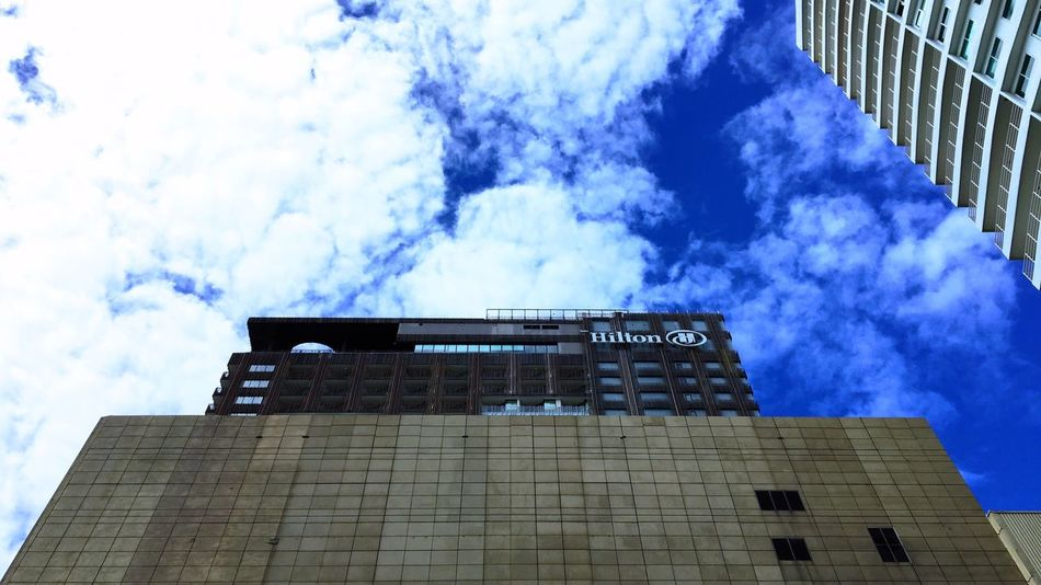 Hilton Architecture Building Exterior Built Structure Low Angle View Day Sky Cloud - Sky Outdoors Skyscraper Modern Travel Destinations No People City