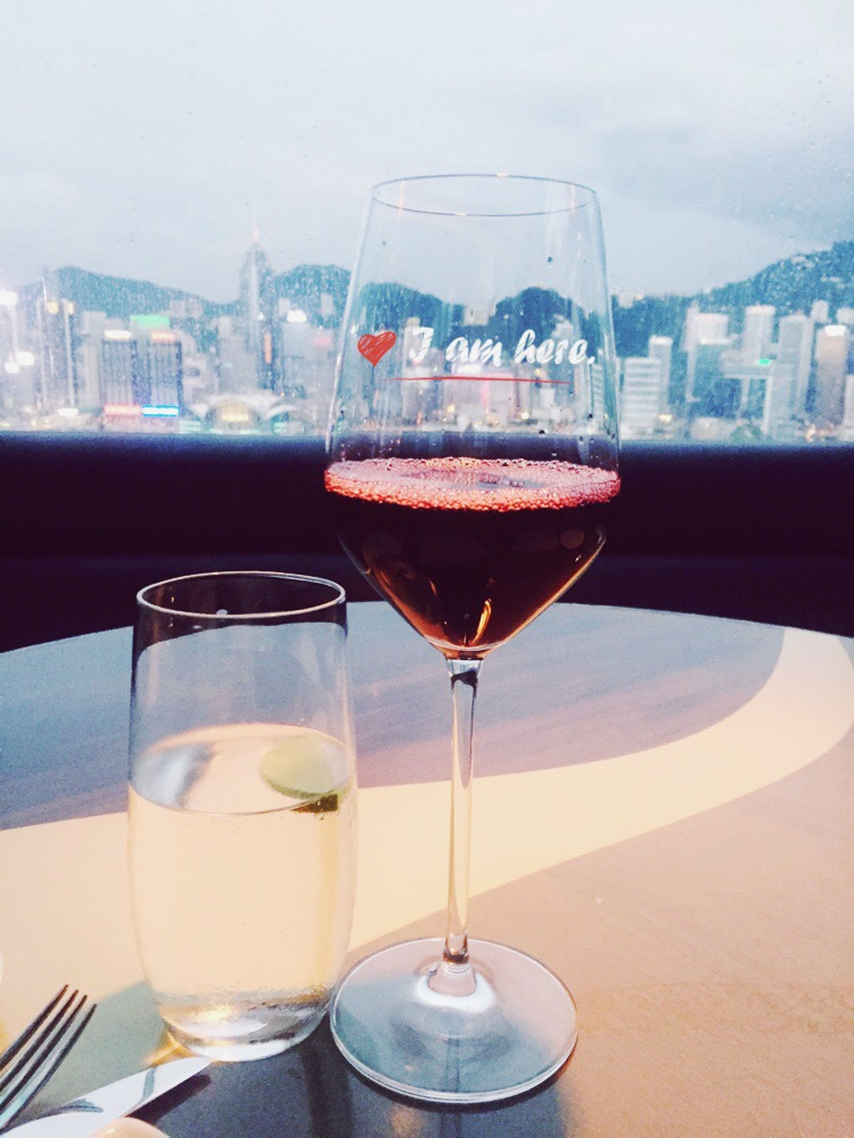 food and drink, drink, refreshment, drinking glass, table, freshness, glass - material, alcohol, transparent, focus on foreground, indoors, close-up, still life, wineglass, drinking straw, restaurant, glass, water, cocktail, wine