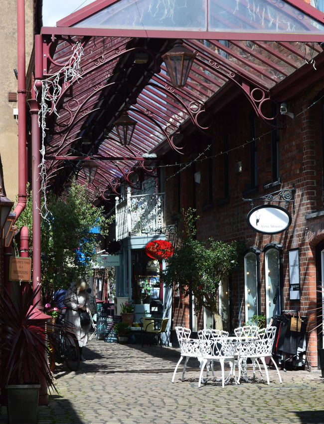 Cafe Coble Stones Getliffe's Yard Leek Posh Shops Shops Summer Time  Sunshine And Shade Victorian Alley Victorian Architecture Victorian Archade Quaint  Old English Tearoom Red Iron Table And Chairs