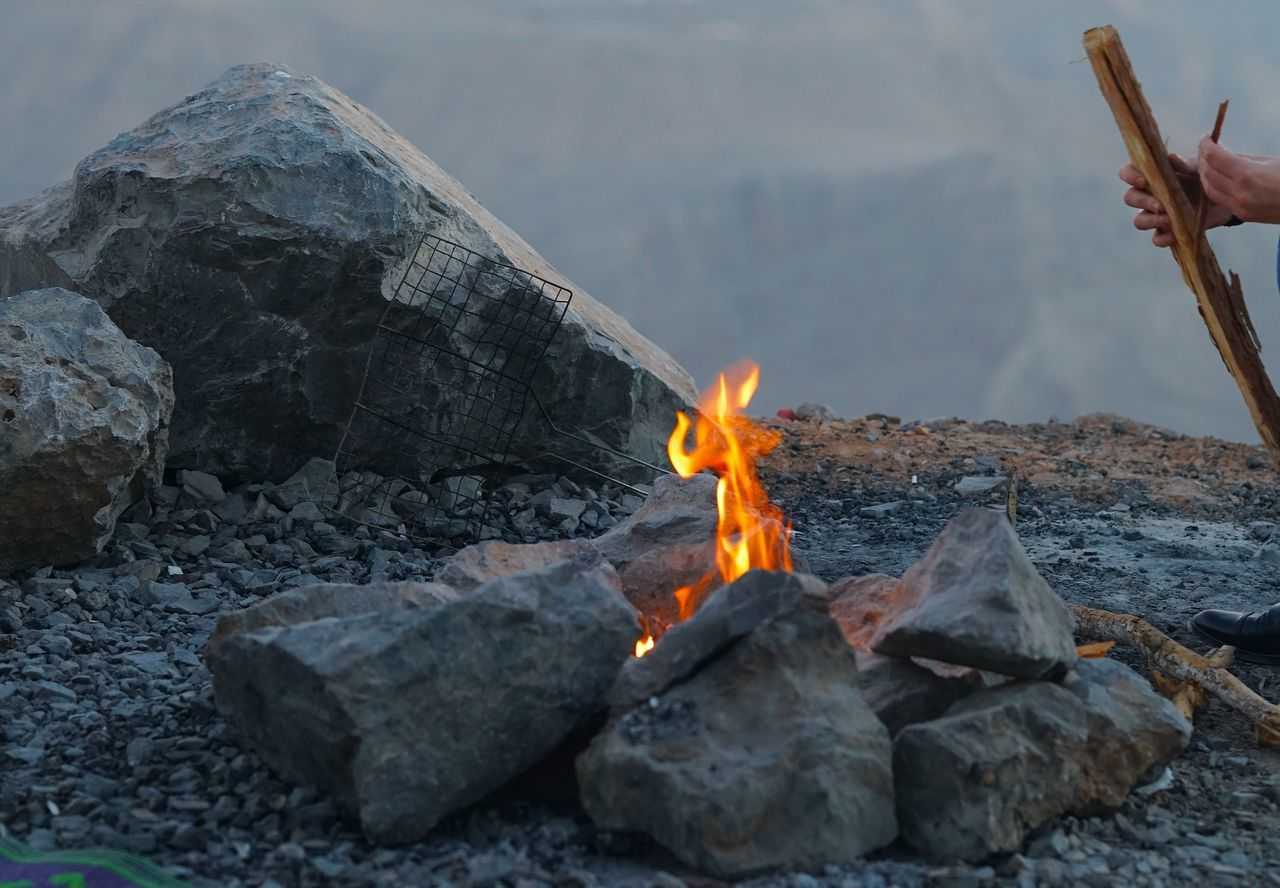 Time to fire up the grill. Burning Day Flame Heat - Temperature Landscape Mountain Nature No People Outdoors Rock - Object Sky Smoke - Physical Structure Travel Traveling