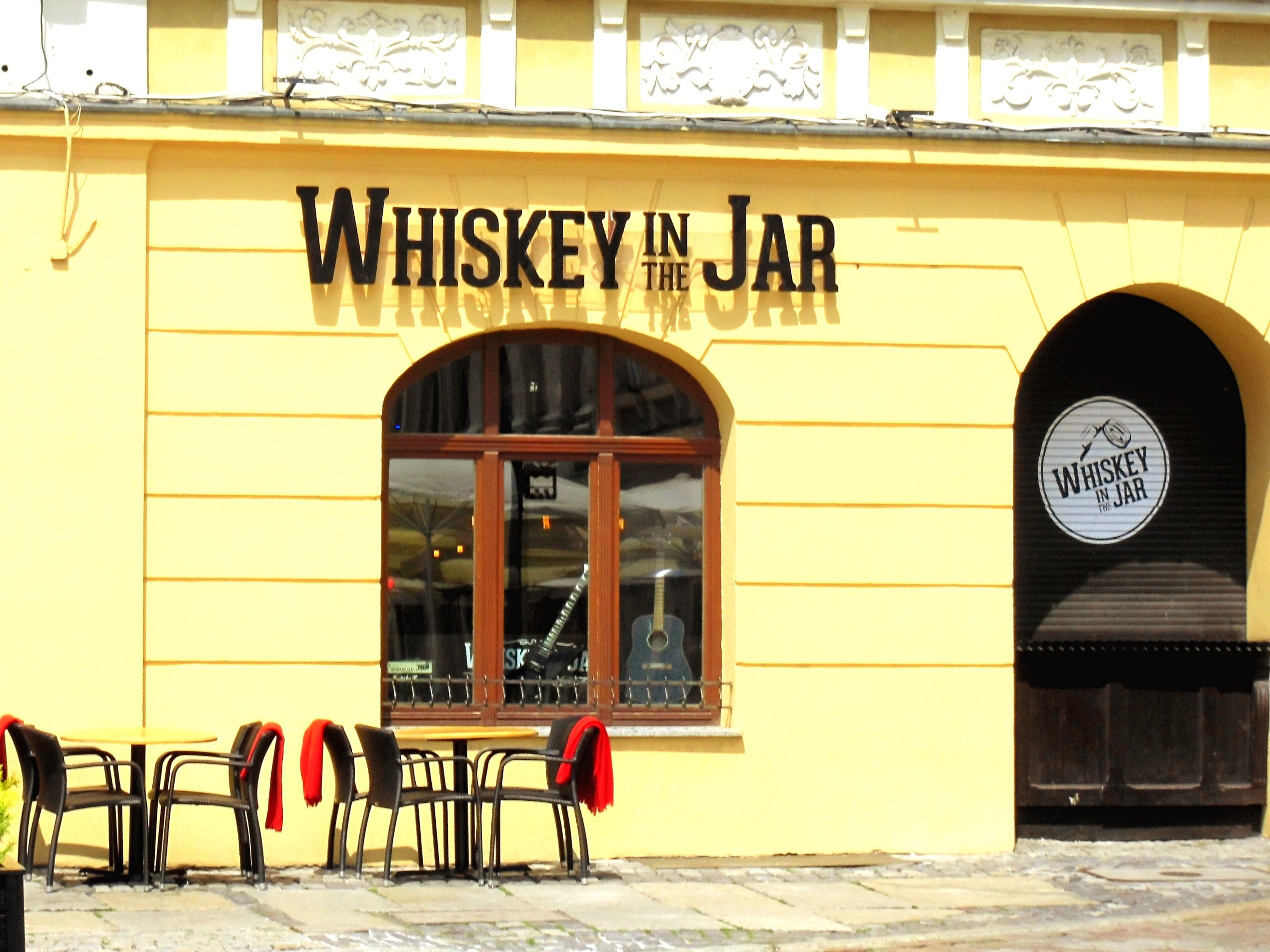 Text Chair Restaurant Table Outdoors Building Exterior No People Day Whiskey In The Jar Poznań Poland Yellow Wall Poznań Poland