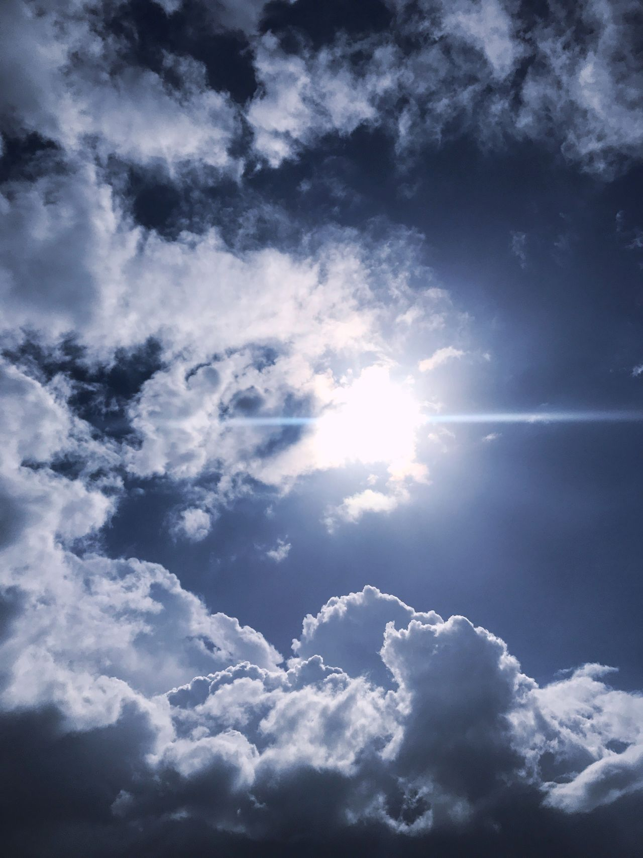 Looking up Bermuda Window To The Sky Sky Cloud - Sky Nature Sun Sunlight Sunbeam Tranquility Beauty In Nature Low Angle View No People Cloudscape Idyllic Backgrounds Fluffy Scenics Cumulus Cloud Day Outdoors Tranquil Scene Sky Only