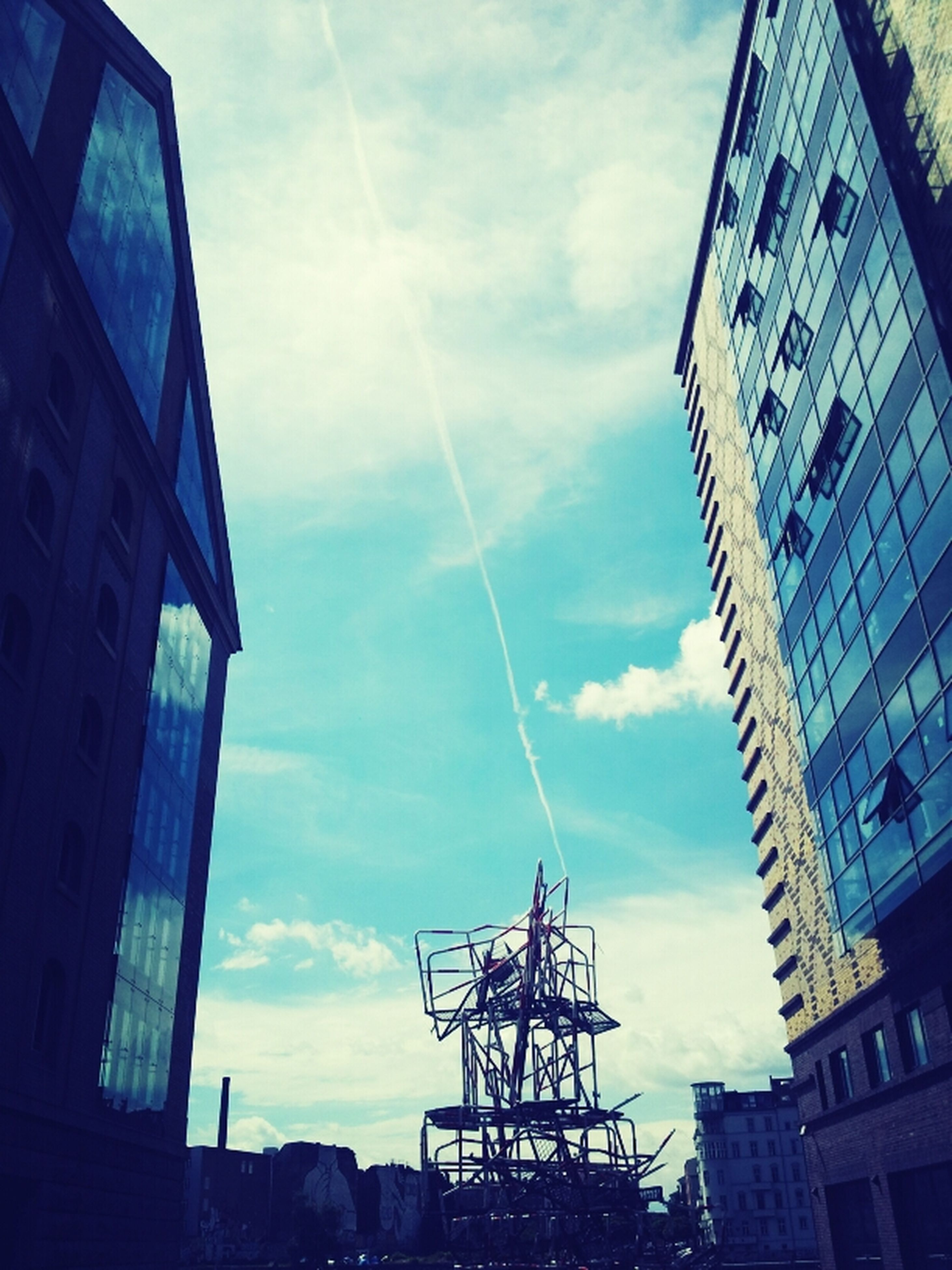 architecture, building exterior, built structure, low angle view, sky, city, building, cloud - sky, modern, office building, glass - material, tall - high, day, cloud, sunlight, skyscraper, outdoors, no people, reflection, tower