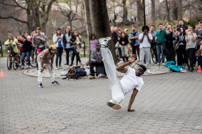 Street performer in Central Park Audience Breakdancing New York City Life Eye Focus On Foreground Fstop Large Group Of People Leisure Activity Lifestyles Nikon Nikond750 Nikonphotography Overcast Park Photography In Motion Street Performer Street Photography Battle Of The Cities NYC