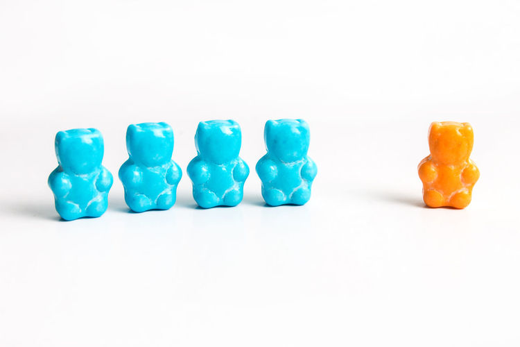 Bear Bears Blue Bully Bullying Business Finance And Industry Candy Choice Civil Rights  Immigrant Immigration In A Row Lesson Lgbt No People Orange Outsider Racism Rain Religion School Studio Shot Sweet Food White Background Work