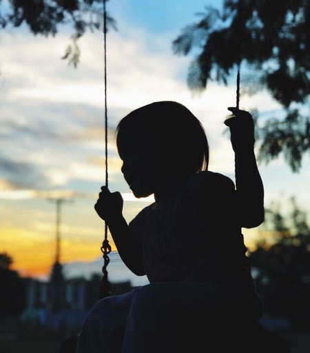 #silhouette #sunset #shadowing #child #silhouette Real People Focus On Foreground Leisure Activity One Person Lifestyles Holding Sky Swing Outdoors Childhood First Eyeem Photo