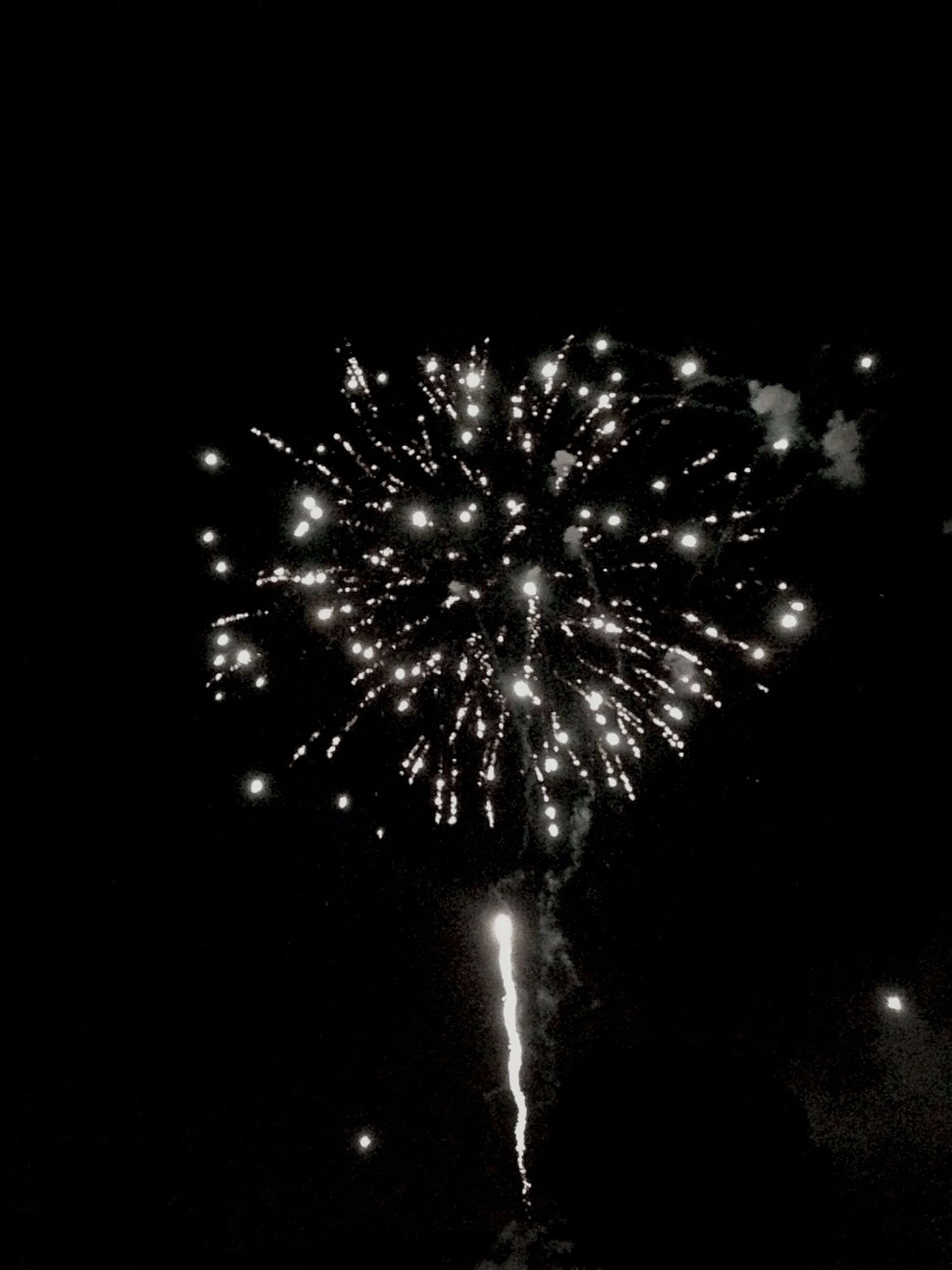 night, illuminated, firework display, celebration, exploding, firework - man made object, glowing, long exposure, event, arts culture and entertainment, motion, sparks, firework, low angle view, entertainment, blurred motion, sky, celebration event, dark, light