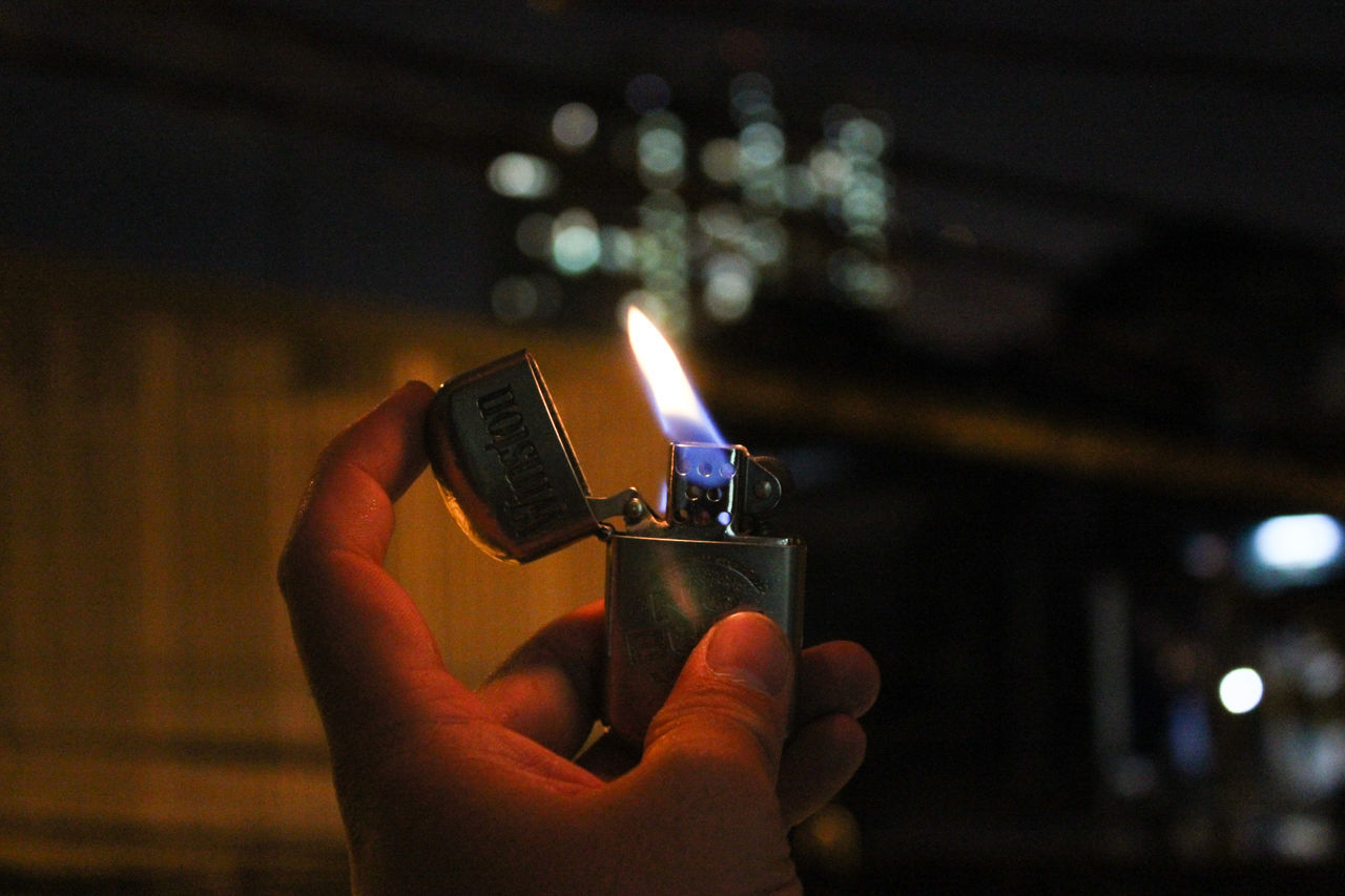 Adult Adults Only Burning Cigarette Lighter Close-up Fire - Natural Phenomenon Flame Heat - Temperature Holding Human Body Part Human Hand Igniting Night One Person Outdoors People Real People Unrecognizable Person
