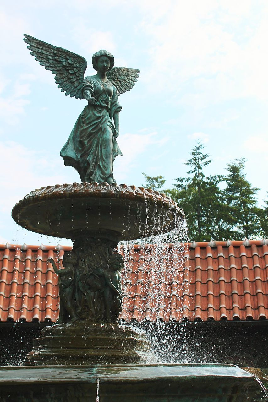 statue, fountain, motion, sculpture, water, low angle view, day, no people, outdoors, long exposure, sky