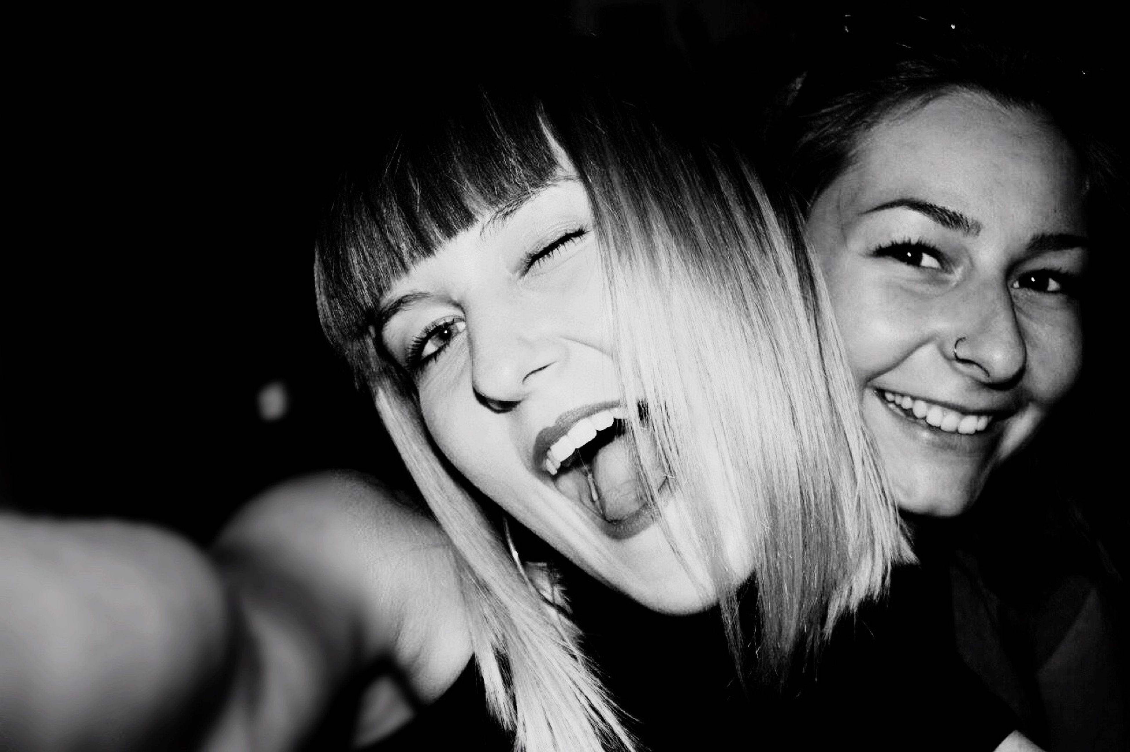 happiness, smiling, two people, young adult, young women, fun, looking at camera, real people, headshot, leisure activity, togetherness, cheerful, portrait, young men, enjoyment, friendship, night, lifestyles, indoors, beautiful woman, close-up, people