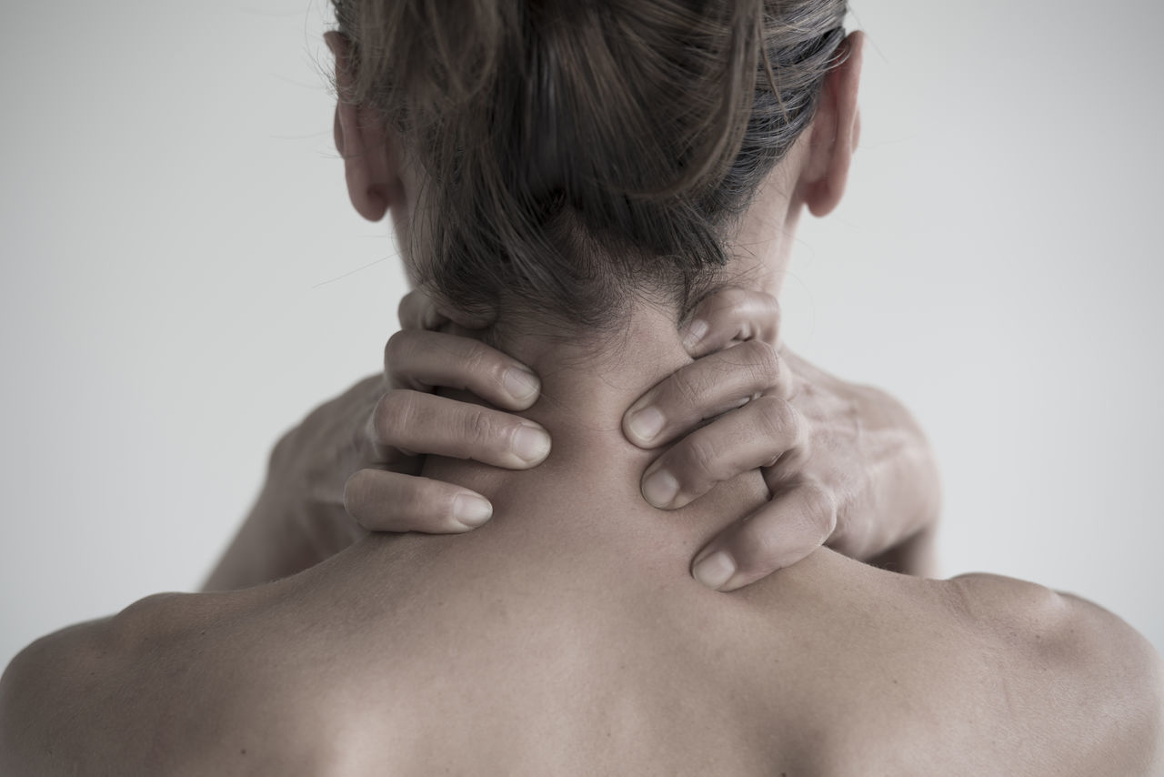Worried woman holding her neck with her hands Adult Anxiety  Close-up Despair Distraught  Fear Fingers Holding Holding On Hopelessness Human Body Part Lifestyles Loneliness Neck One Person One Woman Only Panic Part Of Part Of Body Rear View Sadness Shoulder Studio Shot Woman Worried