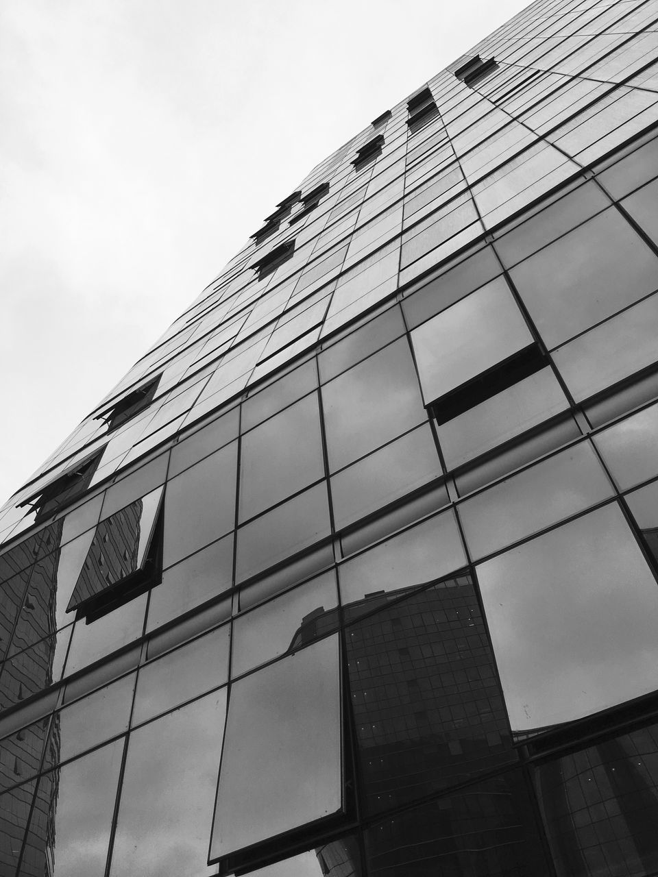 architecture, building exterior, built structure, modern, glass - material, low angle view, building, window, reflection, sky, facade, no people, outdoors, city, skyscraper, day