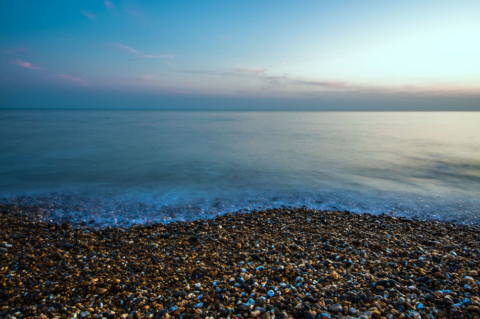 sea sunset Beach Beauty In Nature Horizon Over Water Nature No People Pebble Pebble Beach Scenics Sea Shore Sky Sunset Tranquil Scene Tranquility Water