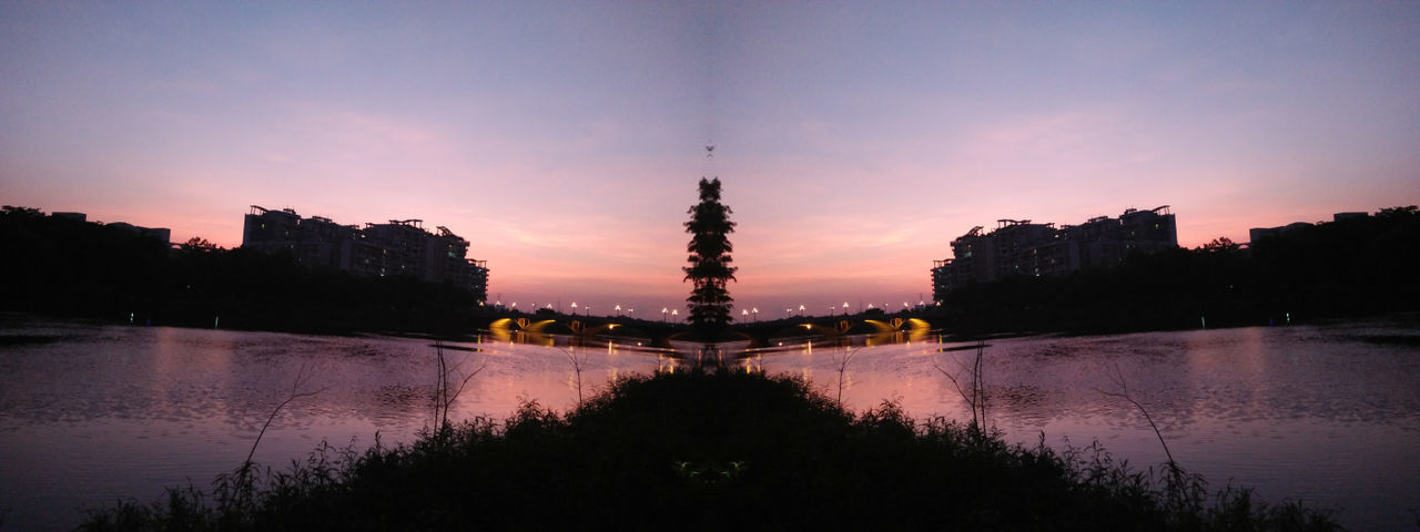 sunset, water, sky, tree, built structure, architecture, silhouette, reflection, outdoors, no people, scenics, nature, beauty in nature, travel destinations, symmetry, building exterior, illuminated, day