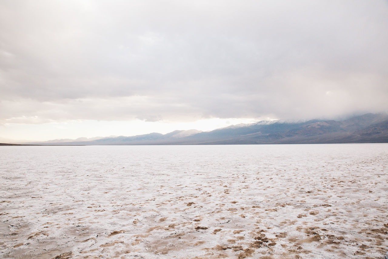Arid Climate Arid Landscape Badwater Basin Beauty In Nature Day Death Valley Death Valley National Park Death Valley, California Desert Desert Landscape Landscape Mountain Nature No People Outdoors Salt Salt - Mineral Salt Flat Scenics Sky Tranquil Scene Tranquility Water