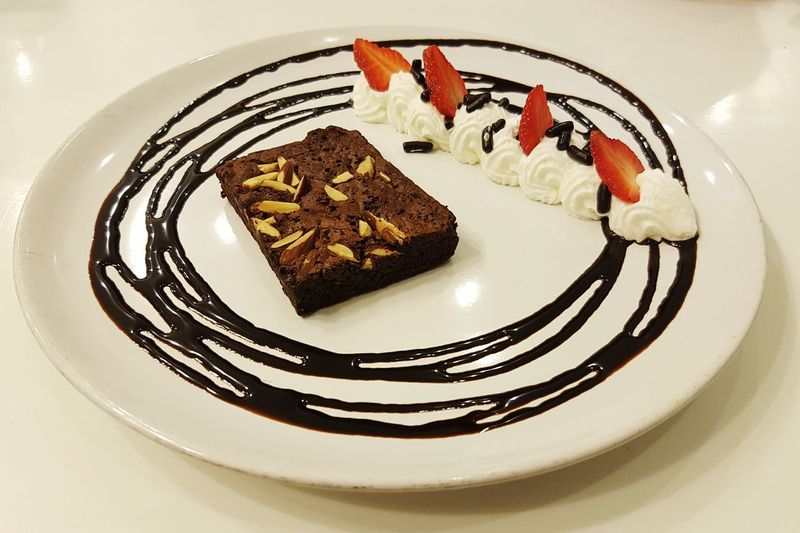 Brownie Brownie Cake Almond Food And Drink Plate Indoors  Freshness Food Sweet Food Ready-to-eat Dessert Still Life Indulgence Unhealthy Eating Temptation Serving Size Meal Appetizer First Eyeem Photo