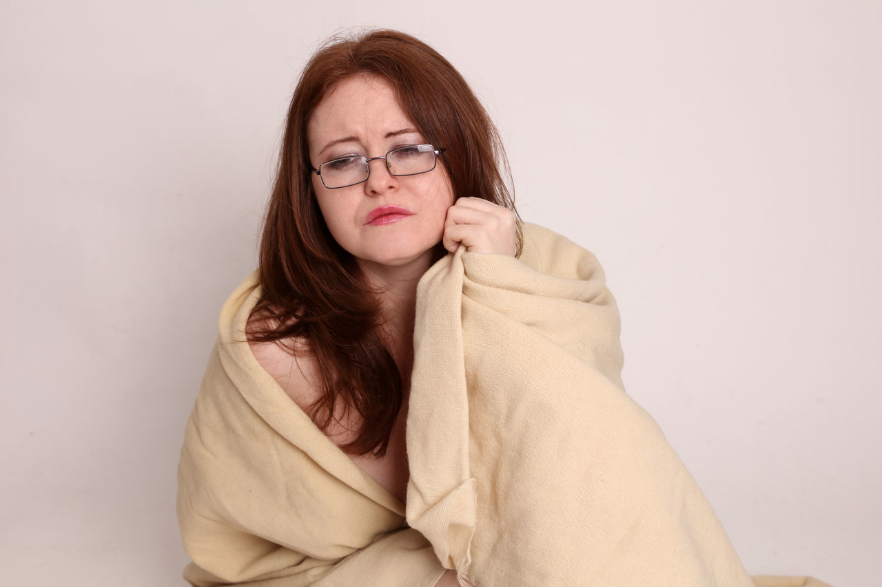 Young geeky woman survivor of awearing just her glasses wrapped in a blanket Attractive Beautiful, Beauty, Blanket Caucasian Cold, Cute Disaster Face Geek Girl, Glasses Hurricane, Pretty Red Head Shipwreck Shipwrecked, Storm Survivor, Twenty, White, Woman Young Young Adult Youth