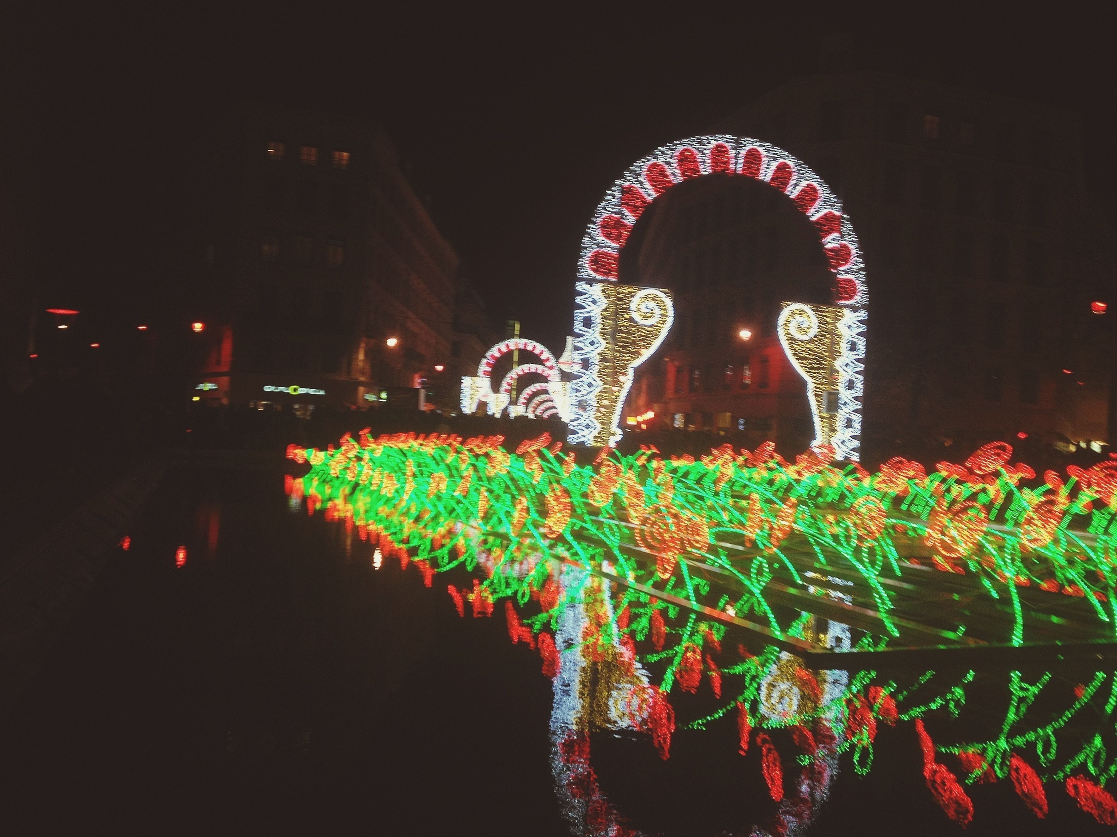 night, illuminated, arts culture and entertainment, long exposure, celebration, lighting equipment, motion, multi colored, leisure activity, blurred motion, outdoors, decoration, amusement park, tree, cultures, glowing, men, light - natural phenomenon, sky