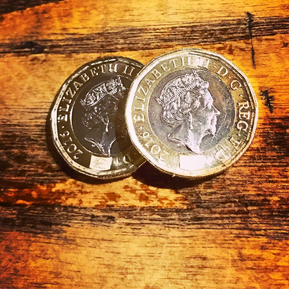The new £1 coin in the United Kingdom Currency Wealth Finance Table Coin Savings Indoors  Close-up No People Day £1 One Pound One Pound Coin One Pound Coins Surrey Godalming Money Money Money Money Money Around The World Moneyshot Cash Sterling Sterling Pound Sterling Silver England