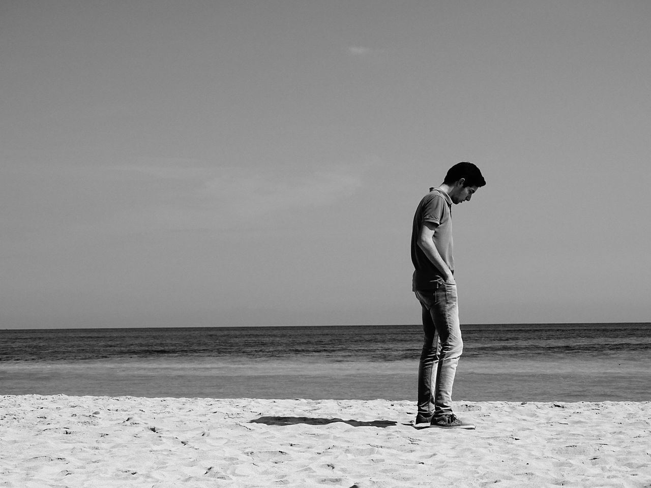 Alone is my name. Alone Beach Blackandwhite Art Full Length Looking Down Casual Clothing One Person Sitting People Outdoors Sand Sea Day Real People Young Adult Horizon Over Water Nature Adult Sky Only Men Adults Only Beach Summer