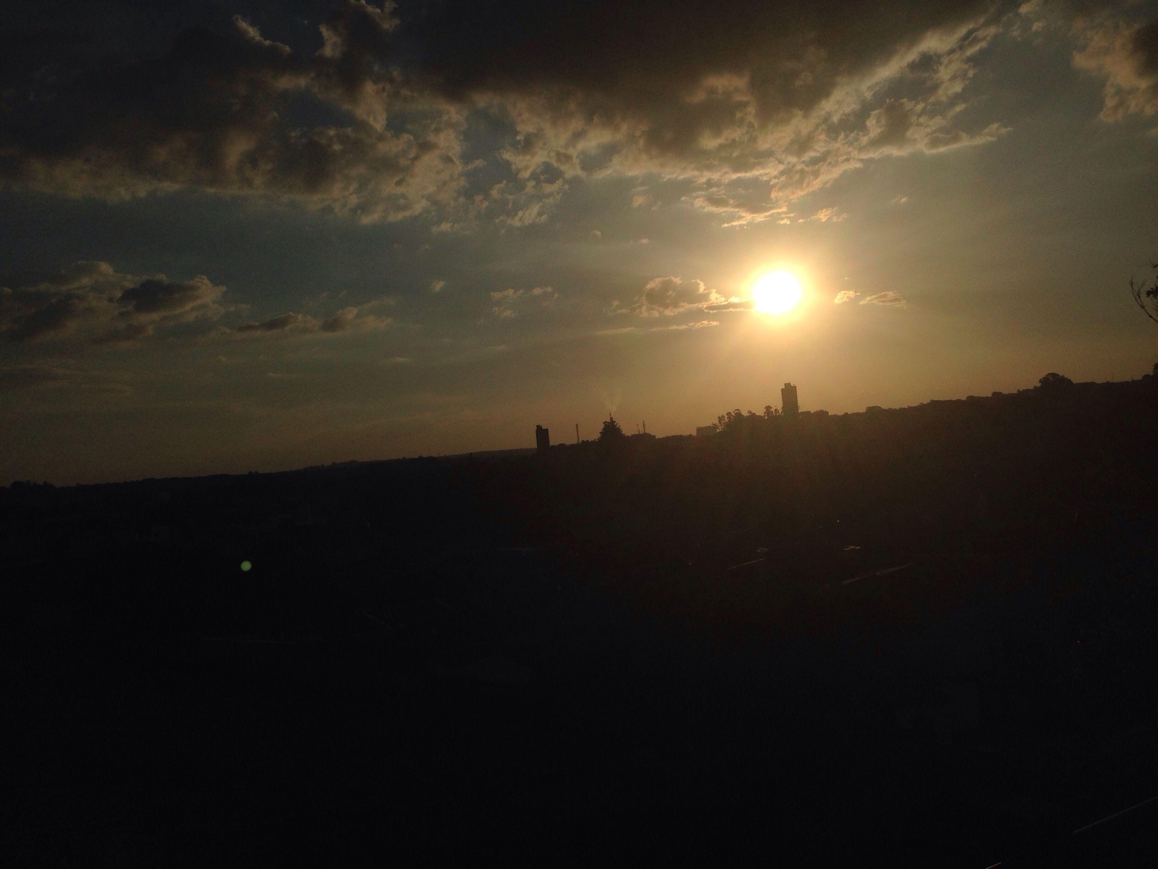 silhouette, sunset, sky, landscape, tranquil scene, scenics, sun, tranquility, beauty in nature, cloud - sky, nature, sunlight, cloud, idyllic, sunbeam, unrecognizable person, outline, outdoors, field
